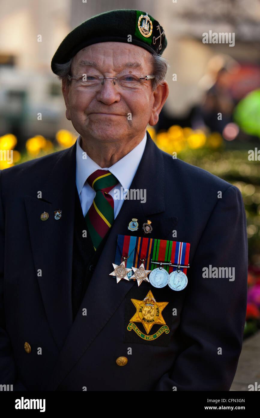 Elderly veteran spectator, wearing his second world war medals - Stock Image