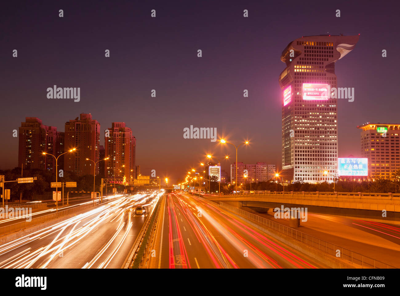 Busy traffic and light trails through city centre, Beijing, China, Asia - Stock Image