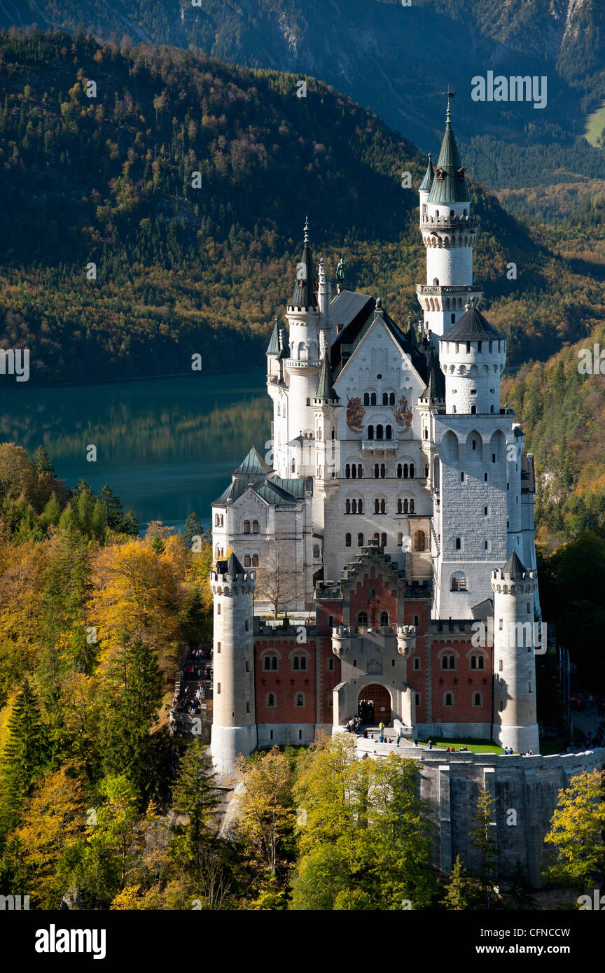 Romantic Neuschwanstein Castle and German Alps during autumn, southern part of Romantic Road, Bavaria, Germany, - Stock Image