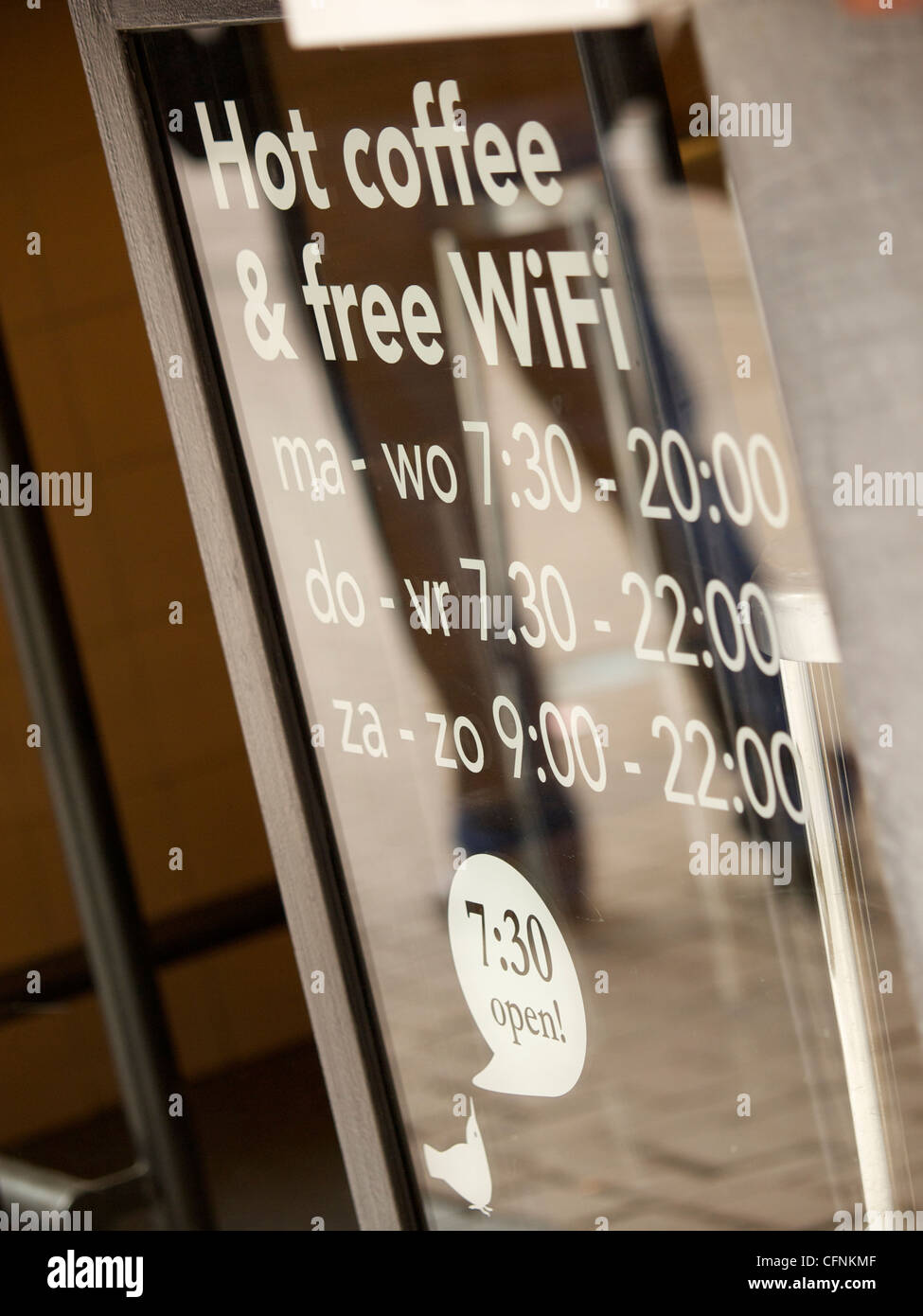 Hot coffee and free wifi sign on cafe door in Amsterdam the Netherlands - Stock Image