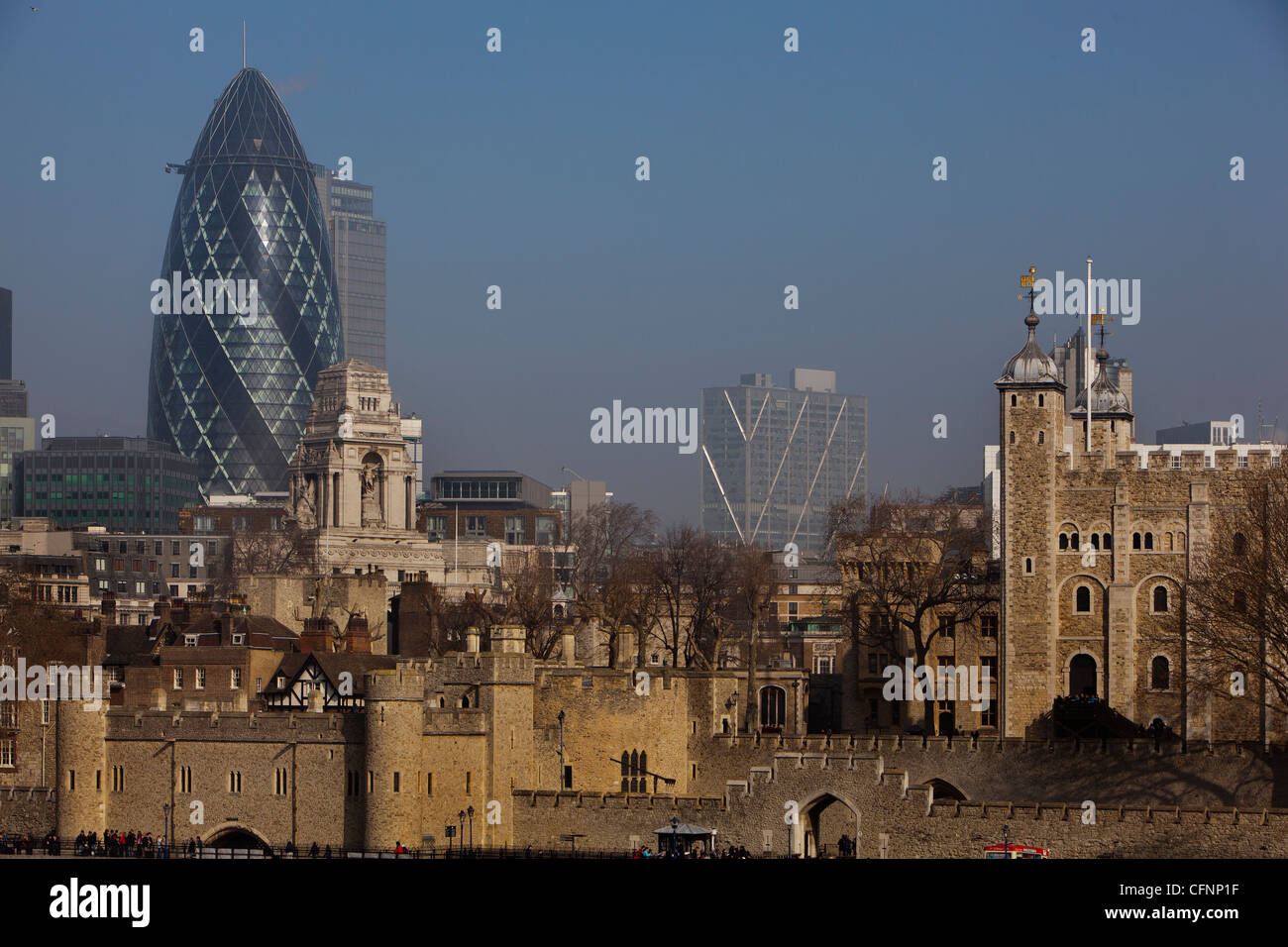 View of the Tower of London and the Gherkin on a misty morning in London - Stock Image