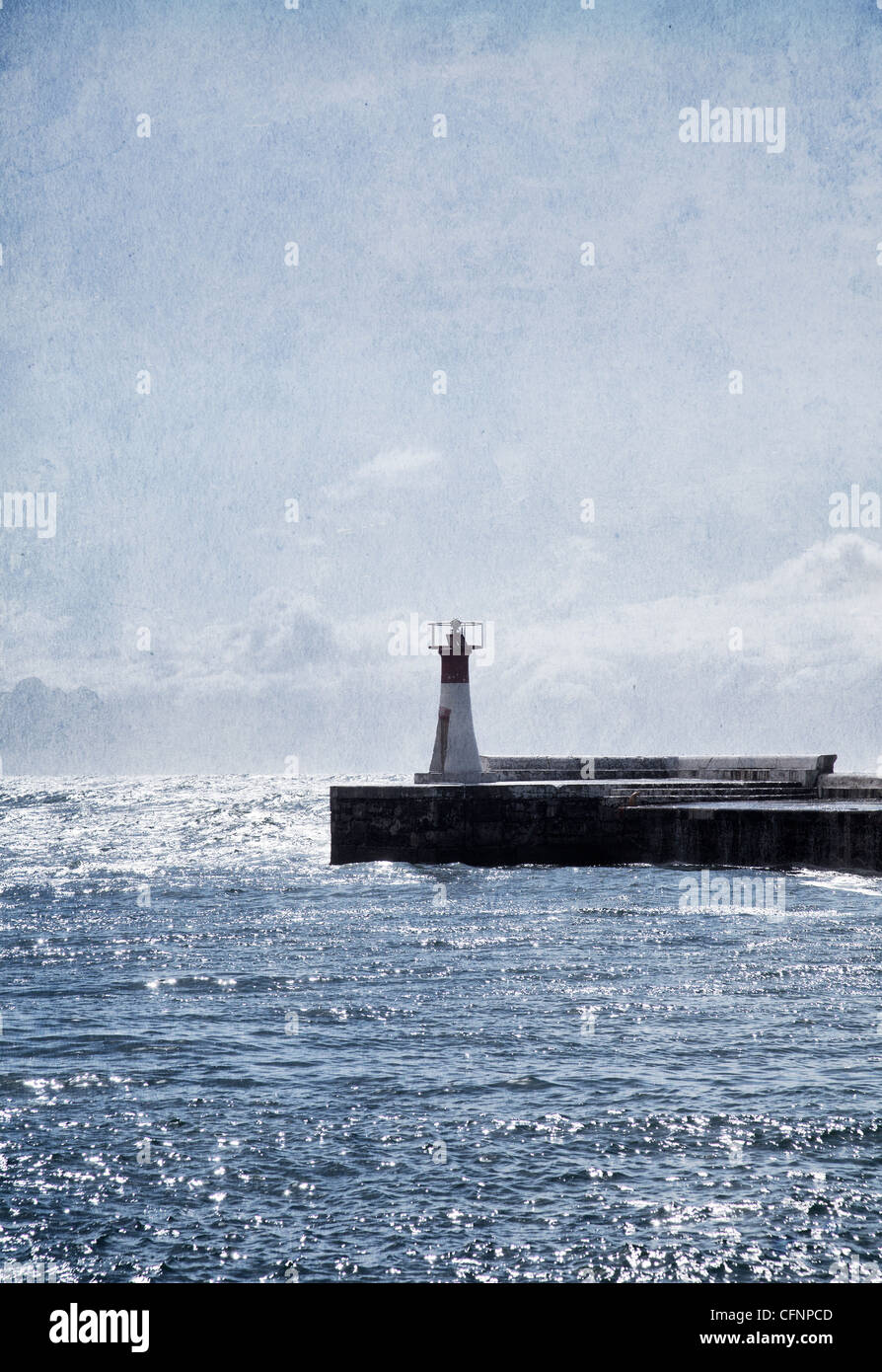 Small Lighthouse on wharf with texture overlay - Stock Image