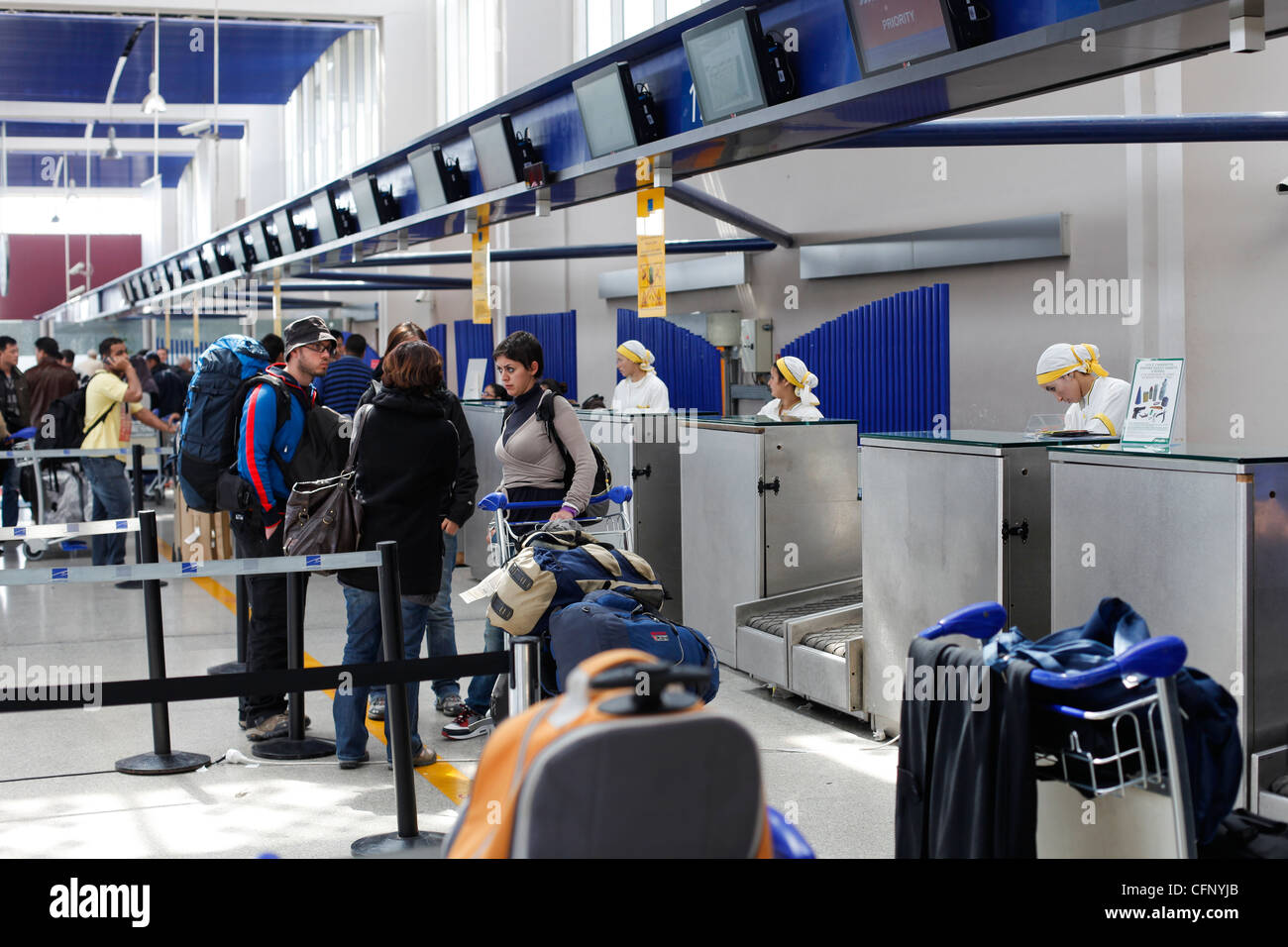 Travellers at checking counters at Airport of Casablanca, Morocco - Stock Image
