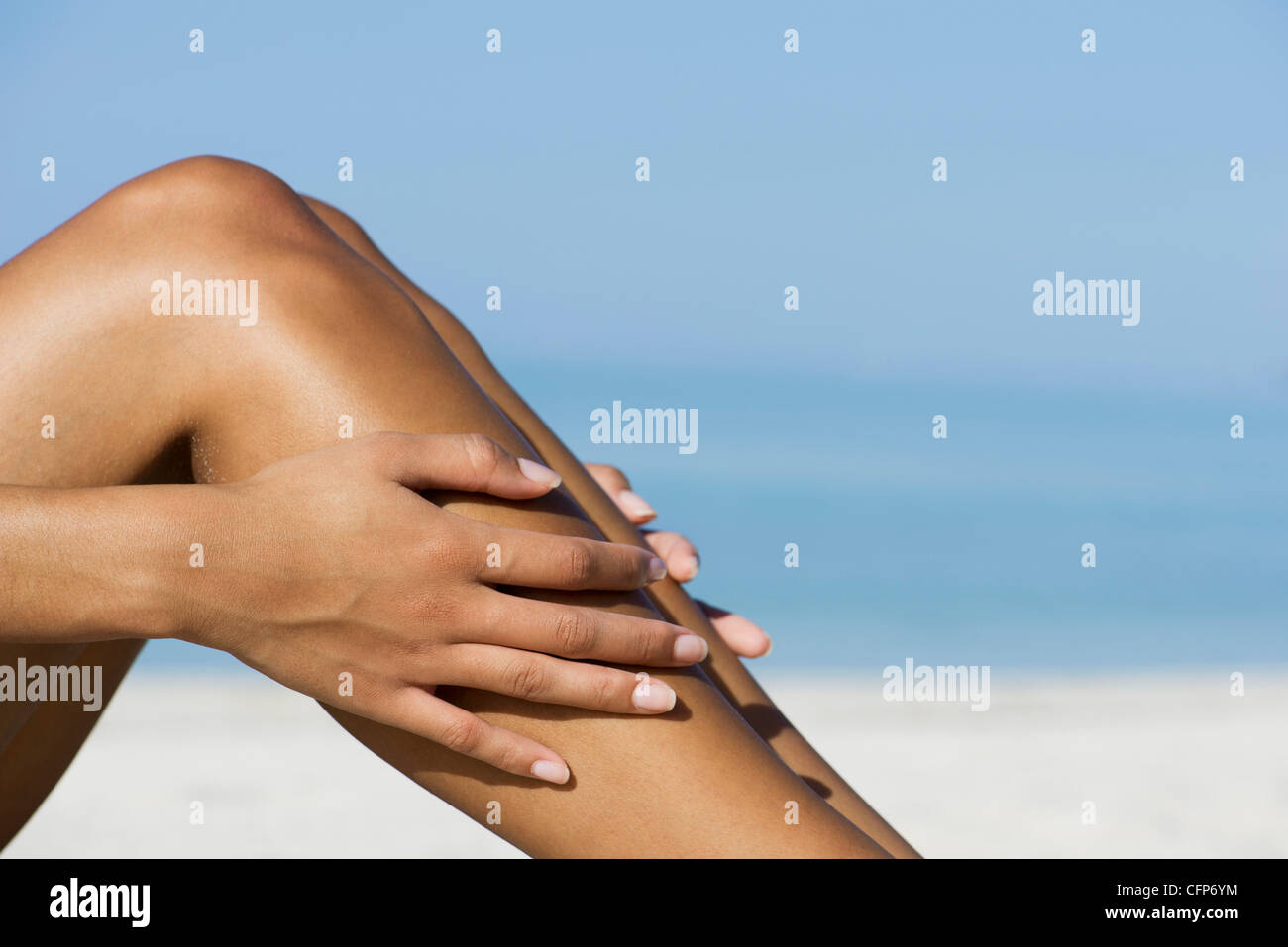 Women relaxing bare in sun