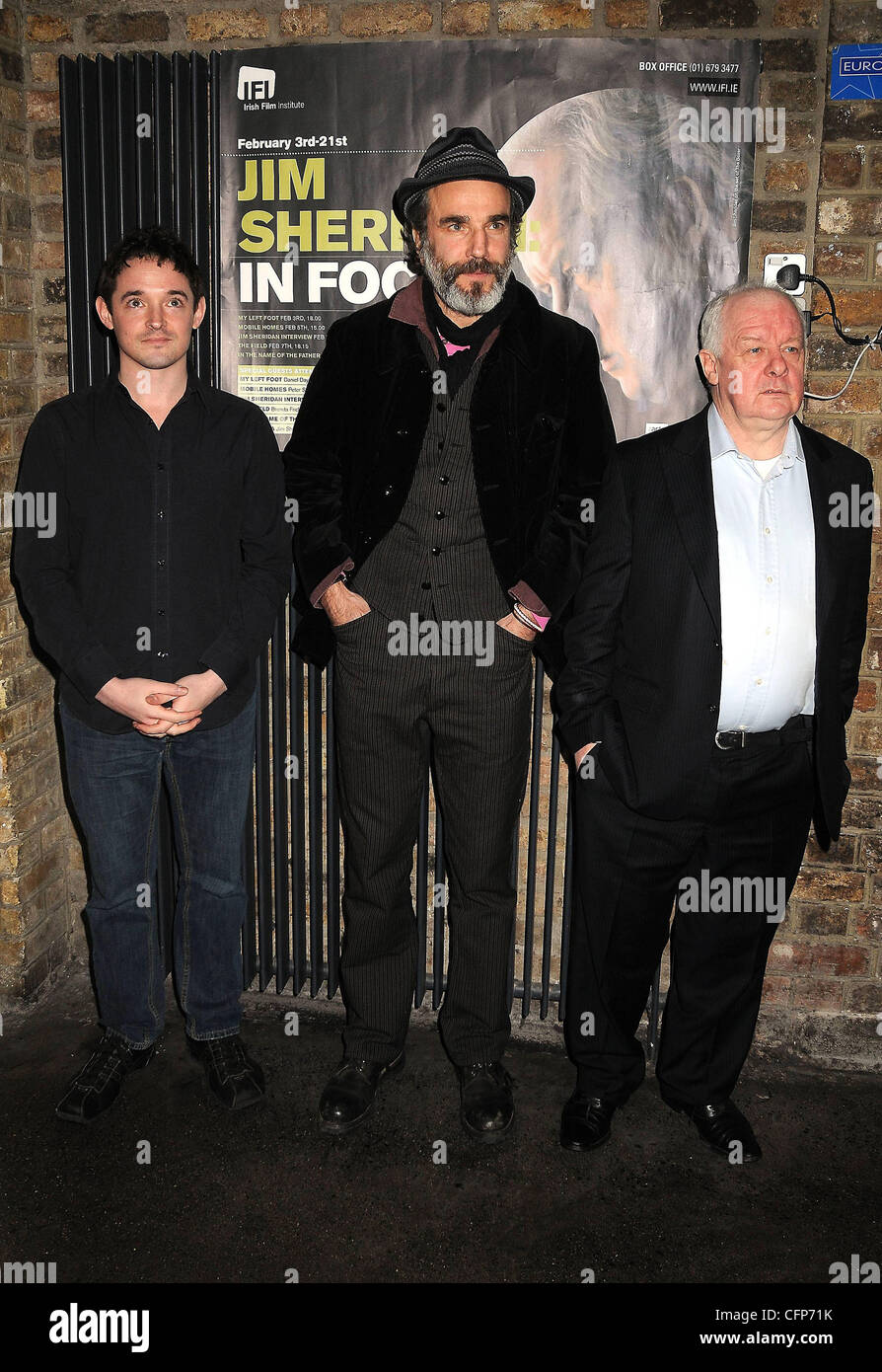 Hugh O'Connor, Daniel Day-Lewis, and director Jim Sheridan at a screening: 'My Left Foot' at the start - Stock Image