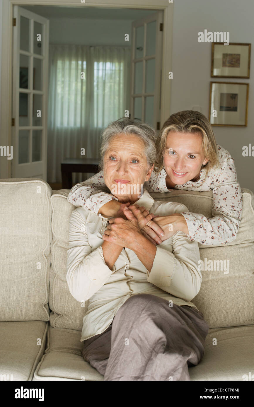 Mother and daughter spending time in living room - Stock Image