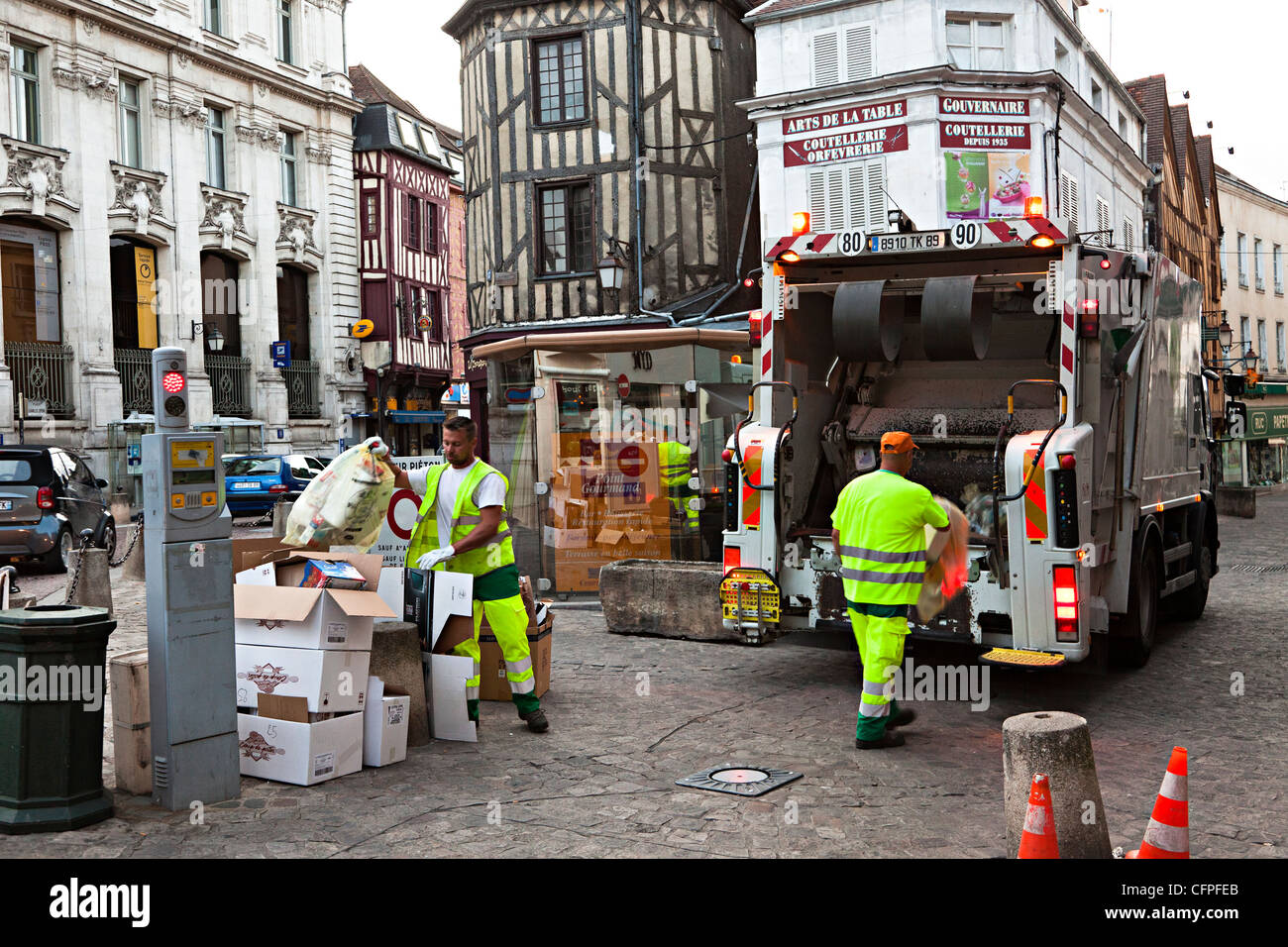 Refuse workers collecting waste in street, Auxerre, Burgundy, France - Stock Image