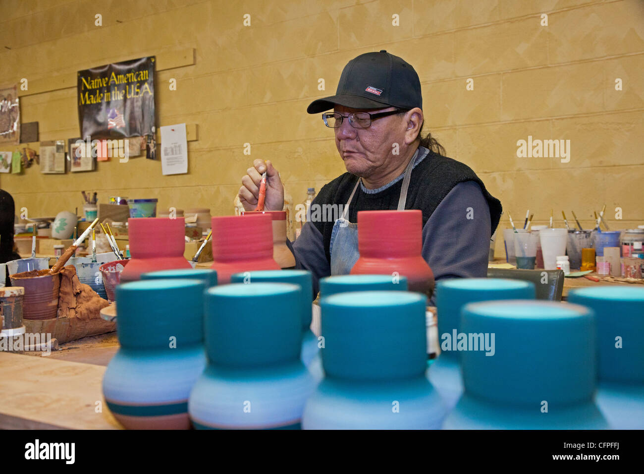 Rapid City, South Dakota - Del Loefer, a member of the Rosebud Sioux, creates pottery at Sioux Pottery. - Stock Image