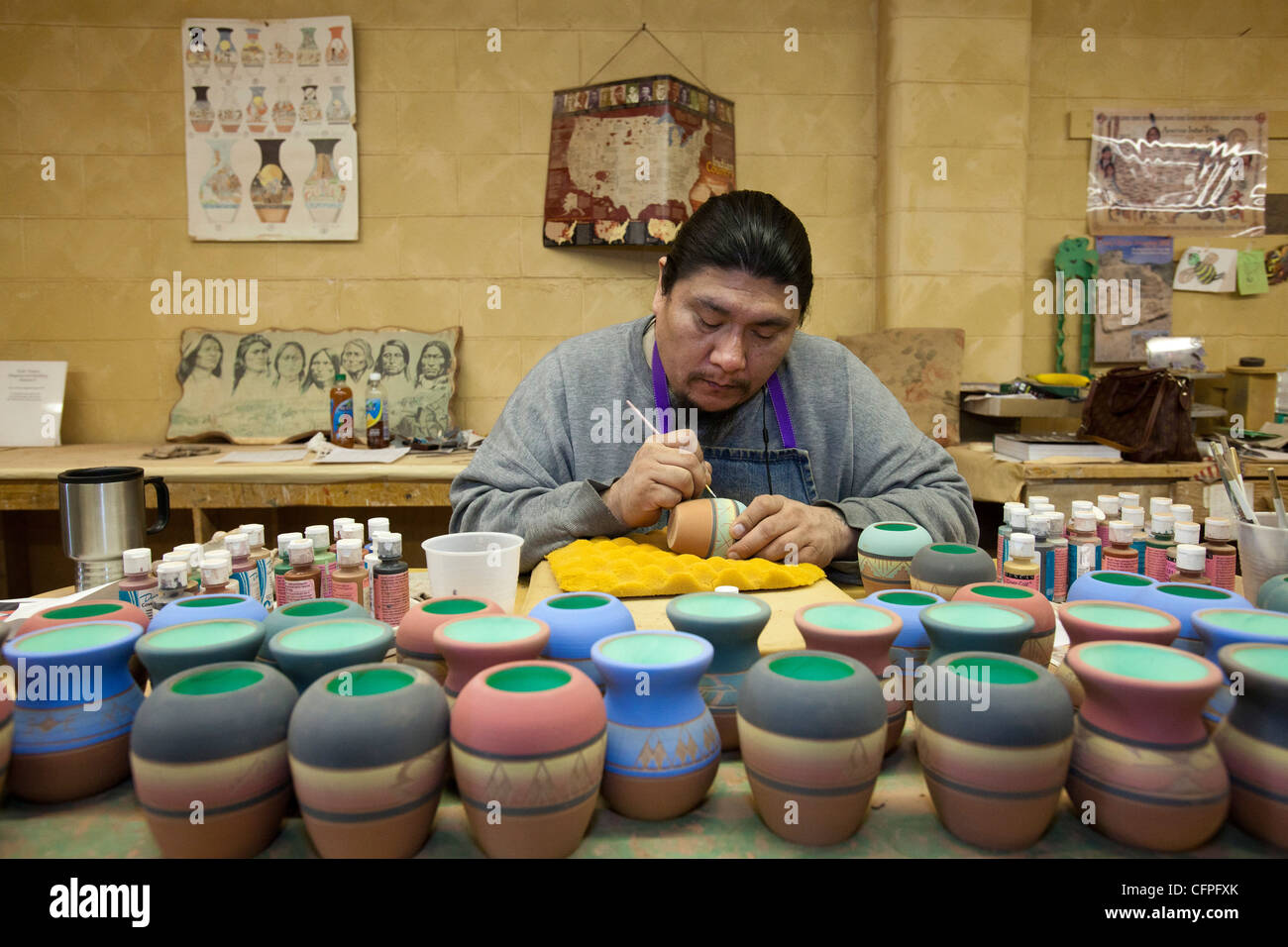 Rapid City, South Dakota - Dorian New Holy, a member of the Oglala Sioux, creates pottery at Sioux Pottery. - Stock Image
