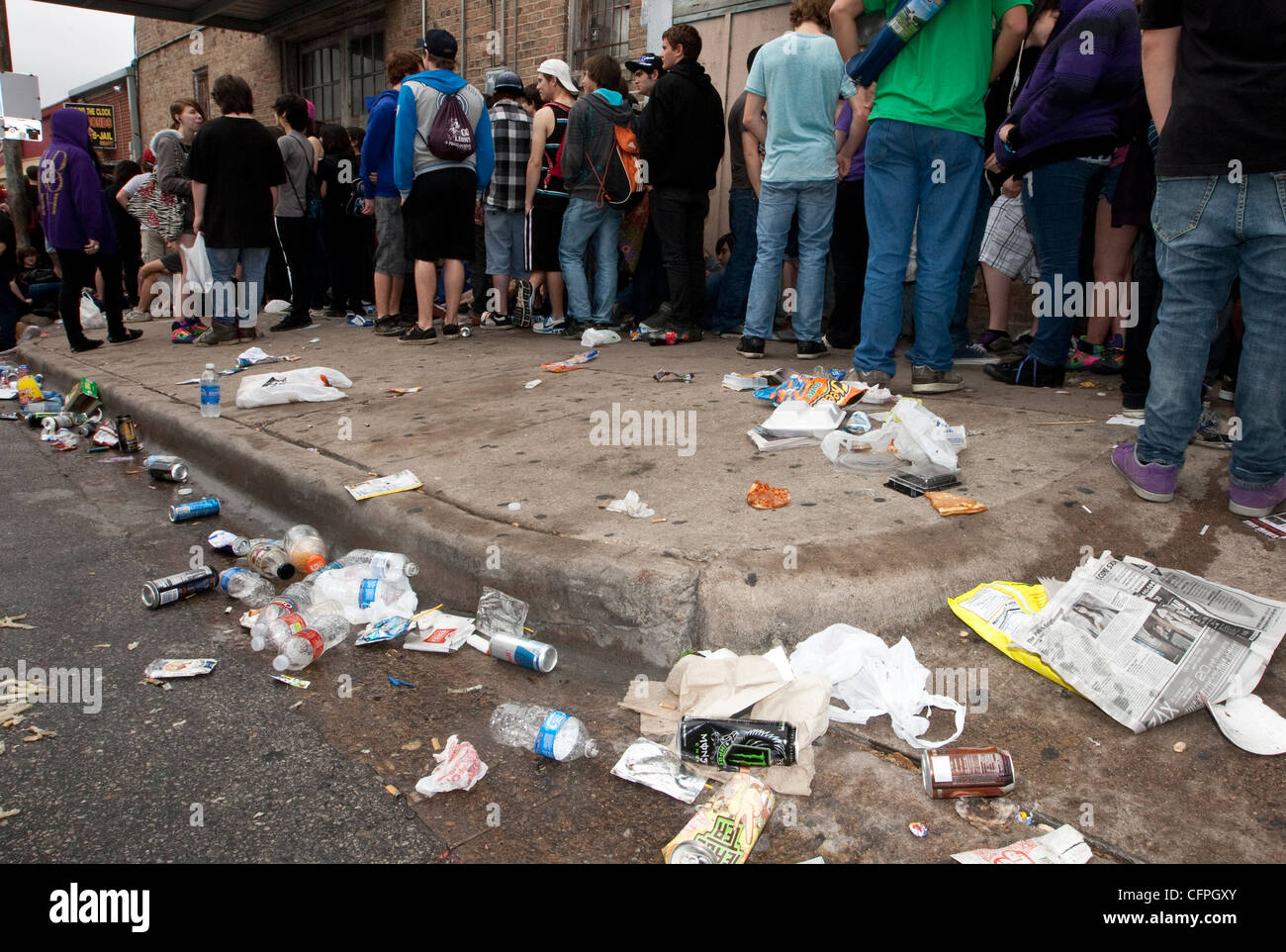 Piles of garbage left on street by attendees of SXSW Music Festival in Austin, Texas which brings in thousands of - Stock Image