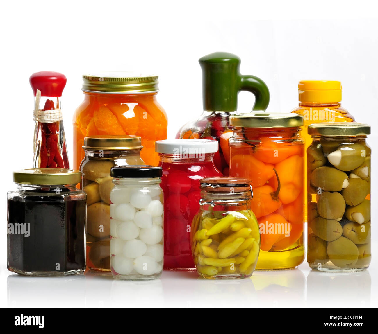 Glass Jars Of Preserved Fruits And Vegetables - Stock Image