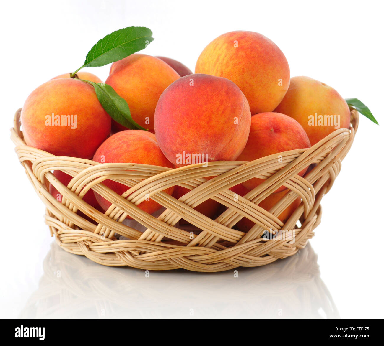 fresh peaches in a basket - Stock Image