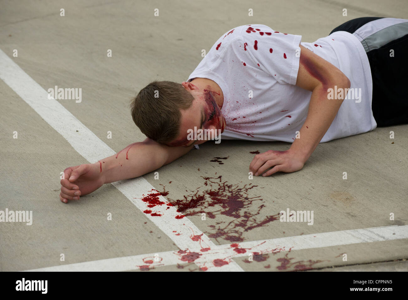 High school students participate in Shattered Dreams Program designed to educate the danger associated with drinking - Stock Image