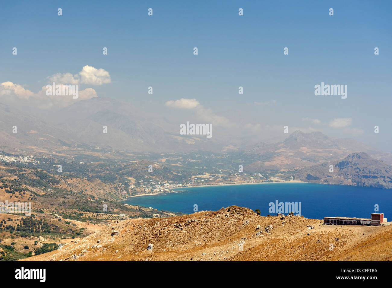 Crete. Greece. View of the resort town of Plakias which is idyllically set with sweeping sandy beach and mountainous - Stock Image
