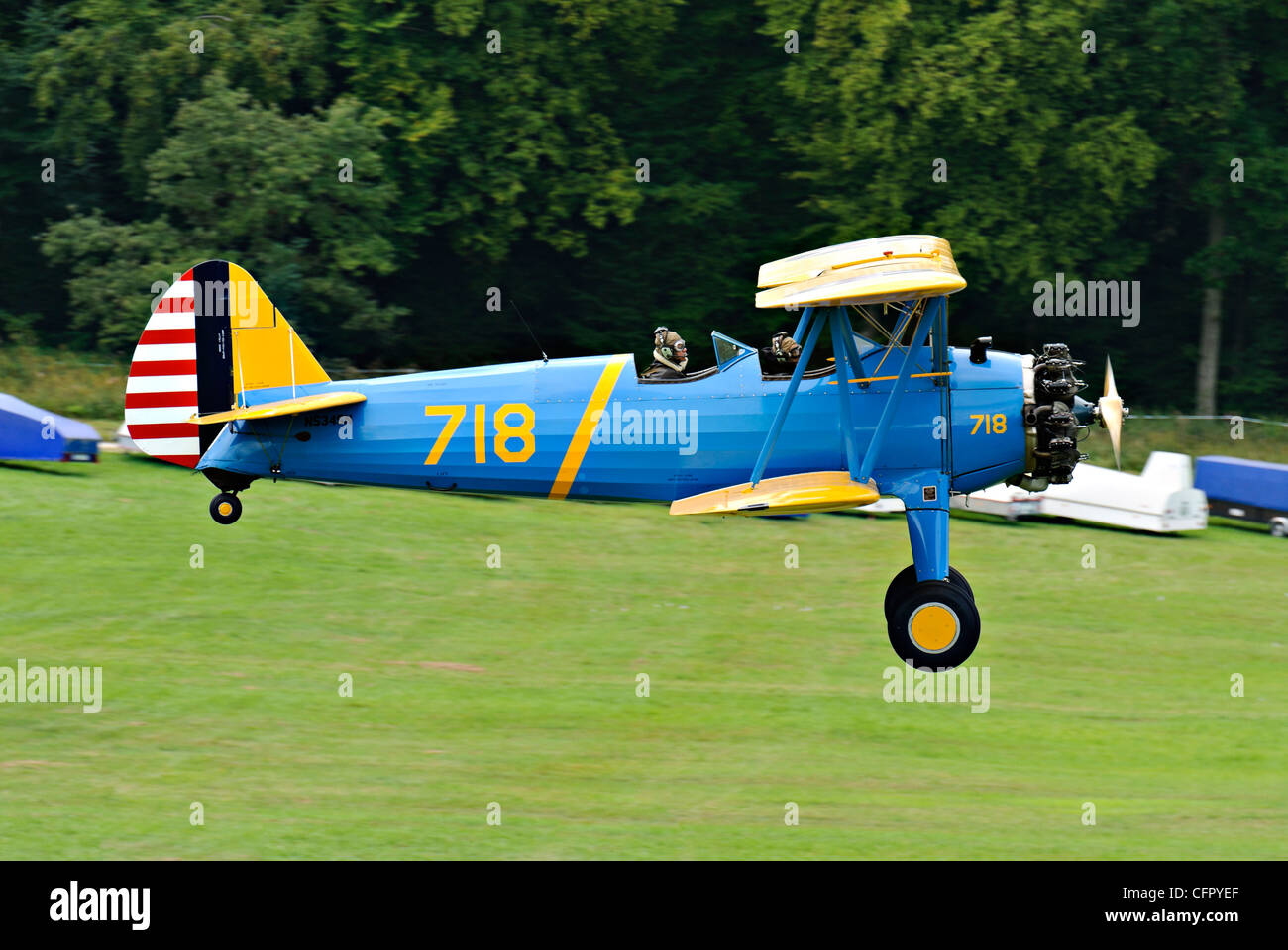 Boeing-Stearman PT-17 biplane landing at the Hahnweide vintage air show, Kirchheim-Teck, Germany  CFPYEF - Stock Image