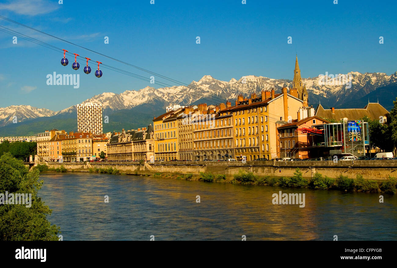 View of downtown Grenoble over the Isère River with les bulles (cablecars) and the French Alps in background. Stock Photo