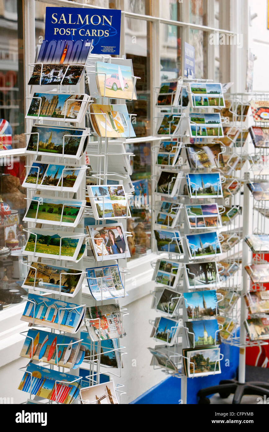 Racks of post cards for sale outside of a UK gift shop - Stock Image