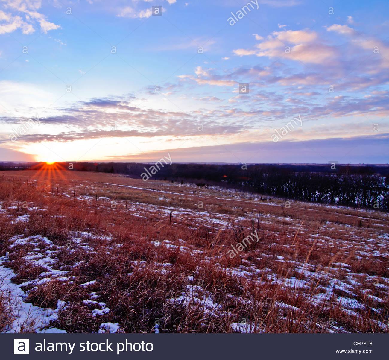 Sunset Along Snowy Flint Hills Nature Trail, Flint Hills East of Council Grove, KS - Stock Image