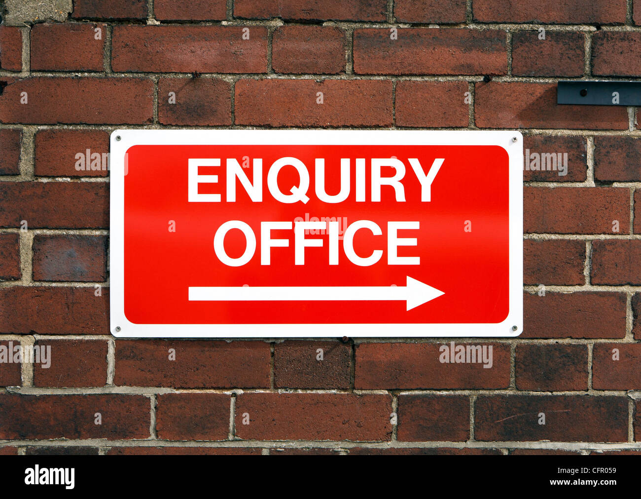 Bright red enquiry office sign UK - Stock Image