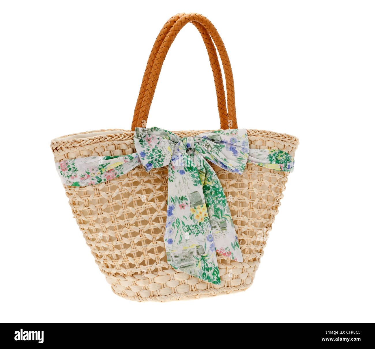 Straw beach bag isolated against a white background - Stock Image