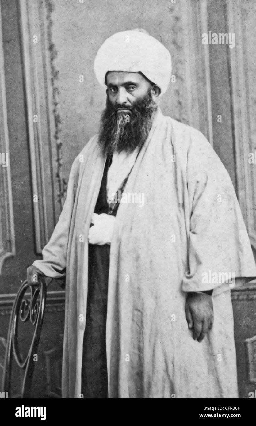Three quarters length portrait of a mullah, circa 1880 - Stock Image