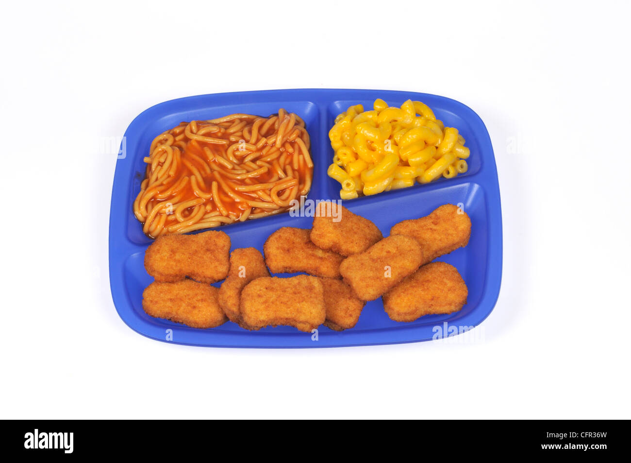 Lunch tray of breaded chicken nuggets, spaghetti with tomato sauce and macaroni and cheese on white background cut - Stock Image