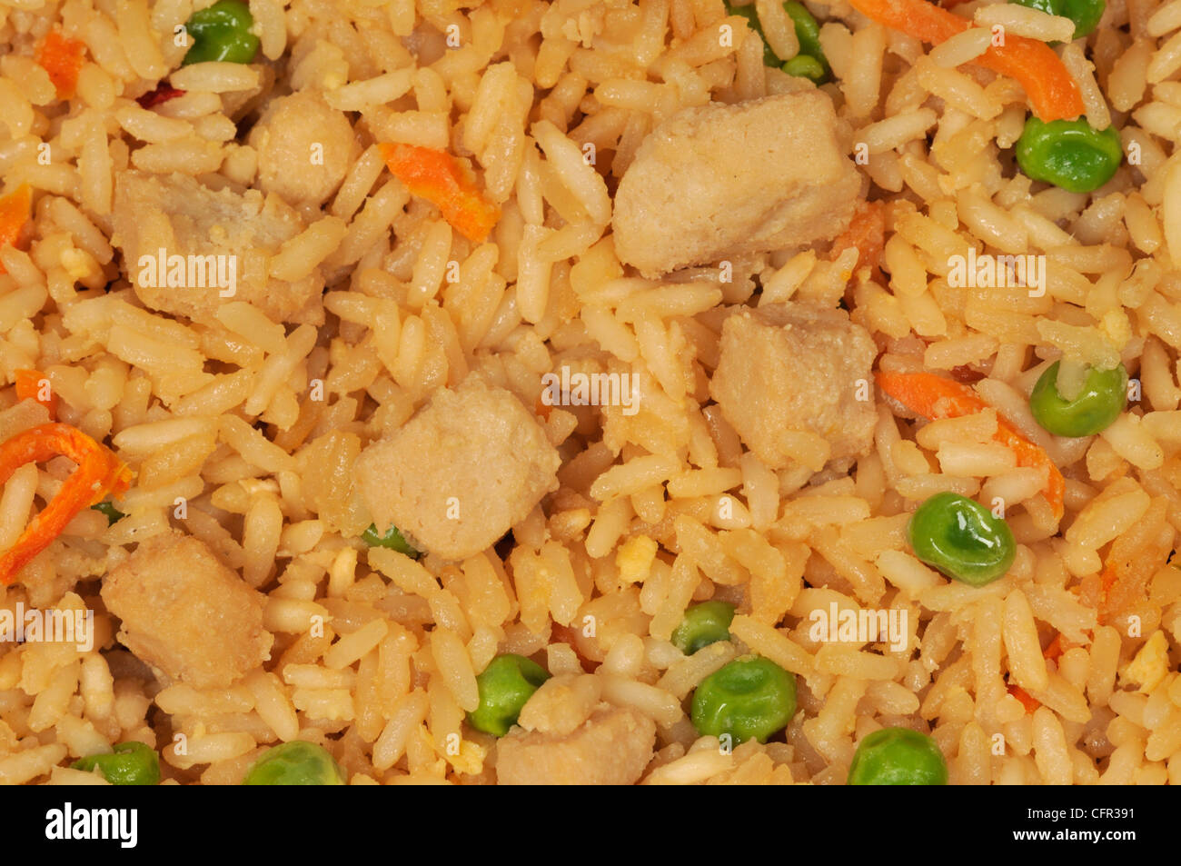 Close-up macro of chicken fried rice with vegetables - Stock Image