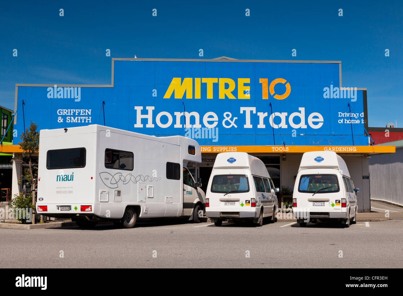 Three campervans parked outside Mitre 10 in Hokitika, West Coast, New Zealand. - Stock Image