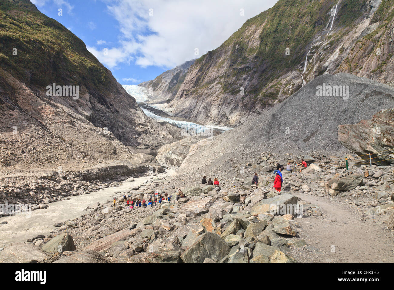 Tourists near the terminal of Franz Josef Glacier, West Coast, New Zealand - Stock Image