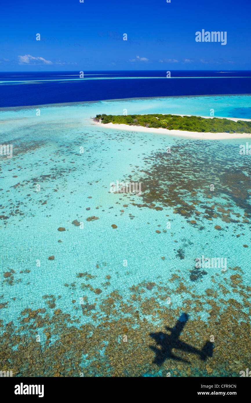 Aerial view of coral reef and deserted island, Maldives, Indian Ocean, Asia - Stock Image