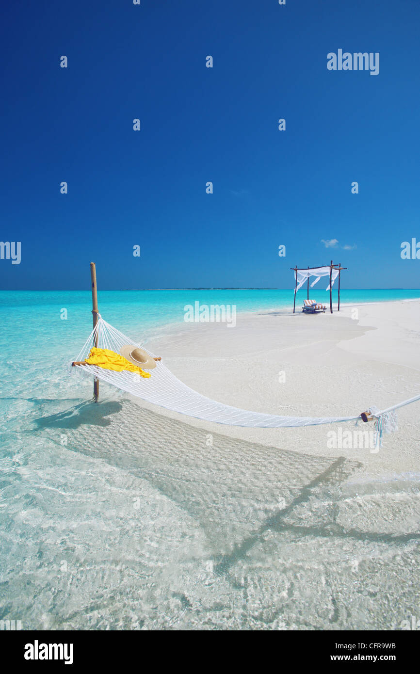 Hammock on tropical beach, Maldives, Indian Ocean, Asia - Stock Image