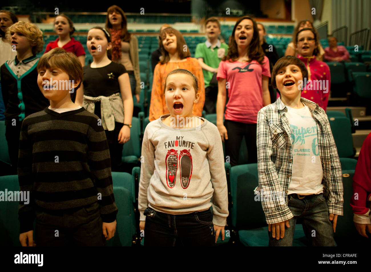 The 'Only Kids Aloud' welsh children's choir rehearsing Mahler's 8th Symphony at Aberystwyth Arts - Stock Image
