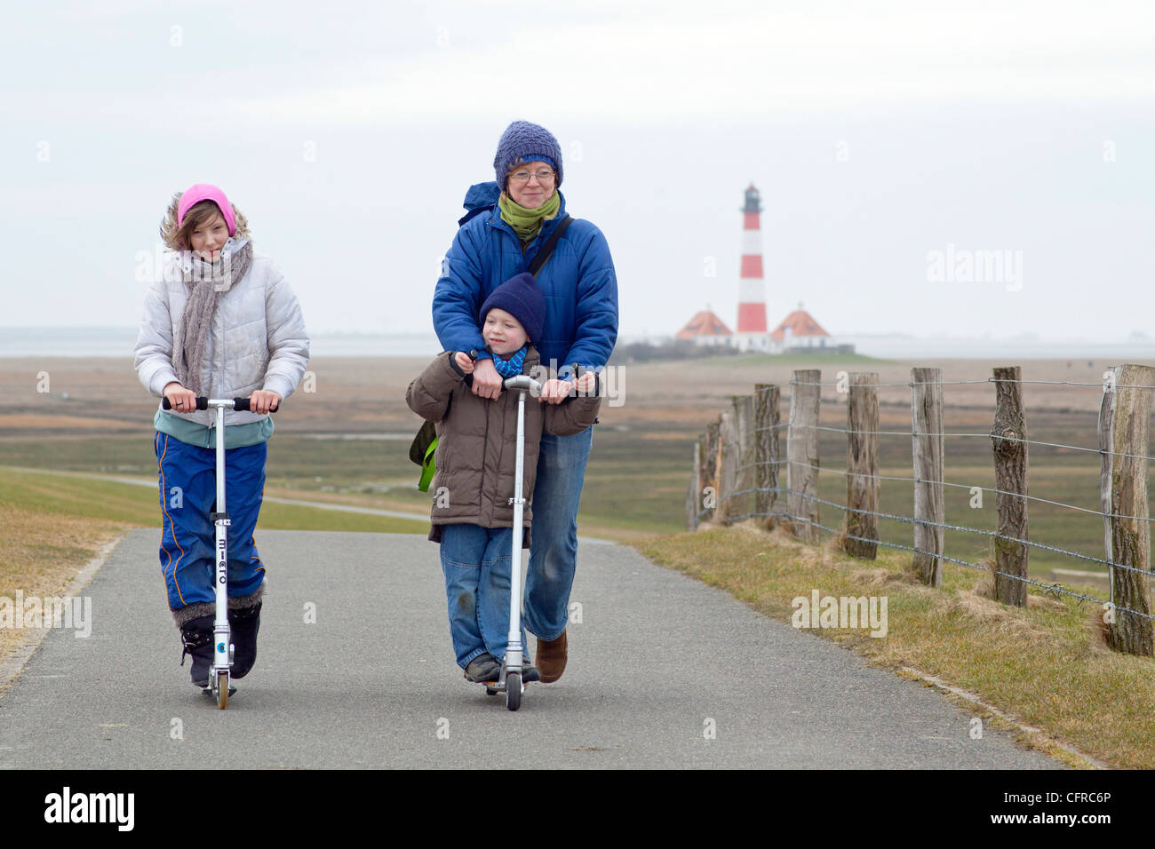 793 Stock Photos Images Page 3 Alamy Hand Some Boy Scooter Wire Diagram A Mother And Her Children Riding In Front Of Lighthouse Westerhever Schleswig