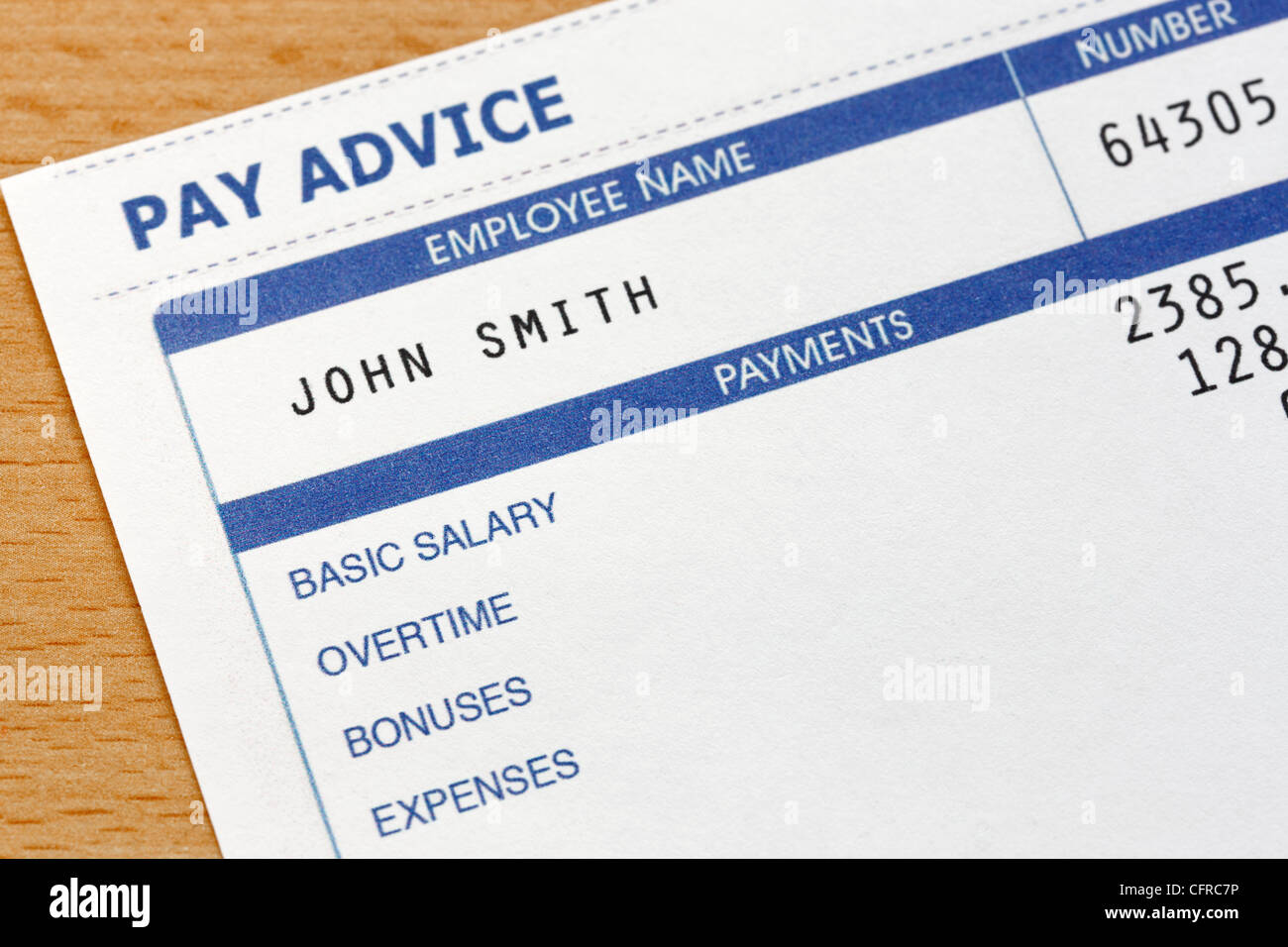 Photo of a payslip. The payslip is a mock up the names and all other information on it is fictional. - Stock Image