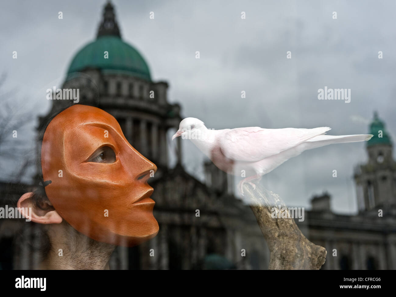Masked mime artist with dove, City Hall, Belfast. Stock Photo
