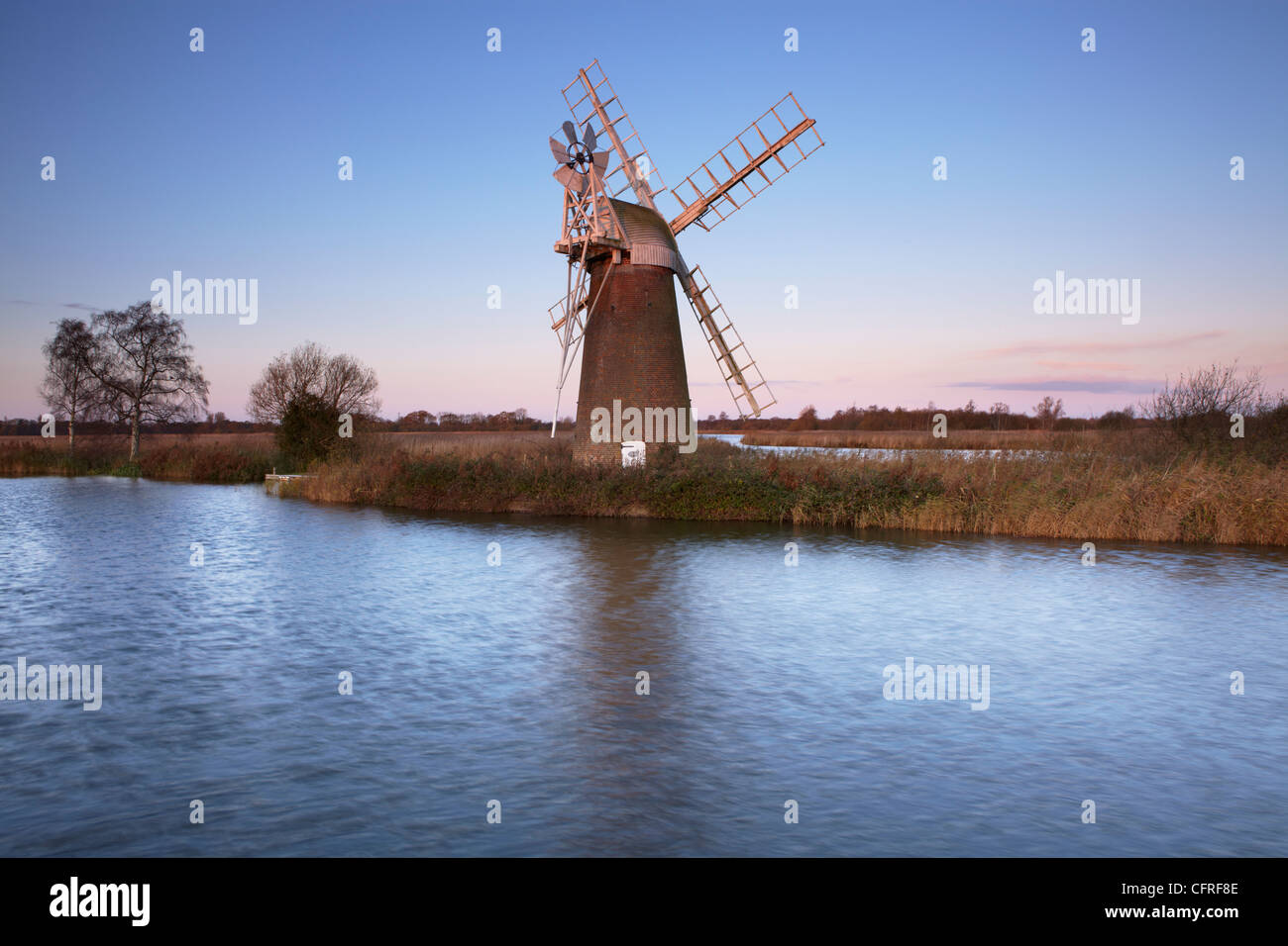 A view of Turf Fen Mill beside the River Ant at How Hill, Norfolk, England, United Kingdom, Europe - Stock Image