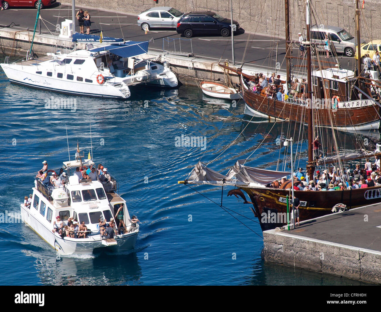 BOAT TRIPS LEAVING  LOS GIGANTES HARBOUR ON WHALE AND DOLPHIN WATCHING EXCURSION  TENERIFE SPAIN - Stock Image