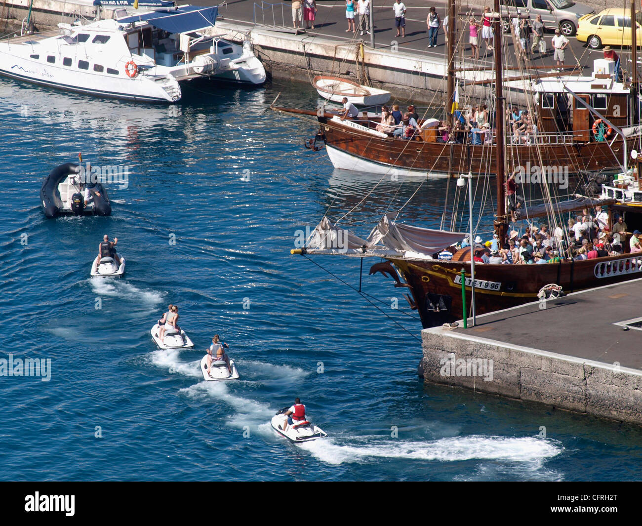JET SKI SAFARI RETURNING TO LOS GIGANTES HARBOUR AND SEA TENERIFE SPAIN - Stock Image