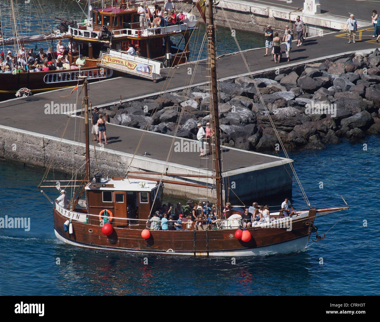 BOAT  LEAVING  LOS GIGANTES HARBOUR WHALE AND DOLPHIN WATCHING TRIP  TENERIFE SPAIN - Stock Image