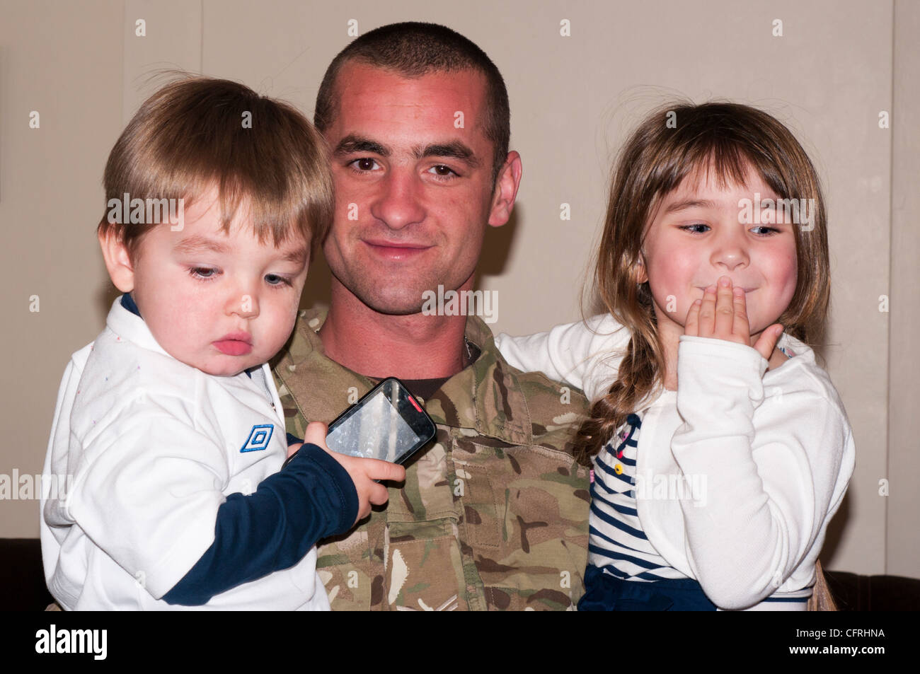 British Army Soldier In Uniform With His Children - Stock Image