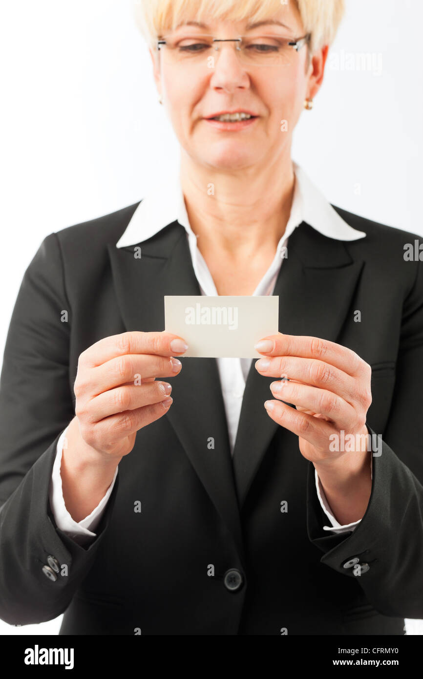 Mature woman showing her business card, closed-up Stock Photo