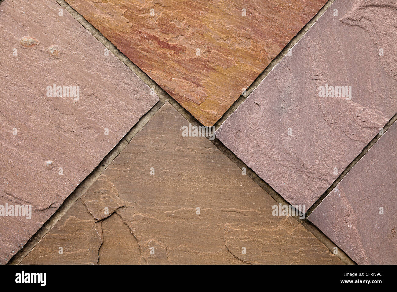 Sandstone flagstones in patio, UK - Stock Image