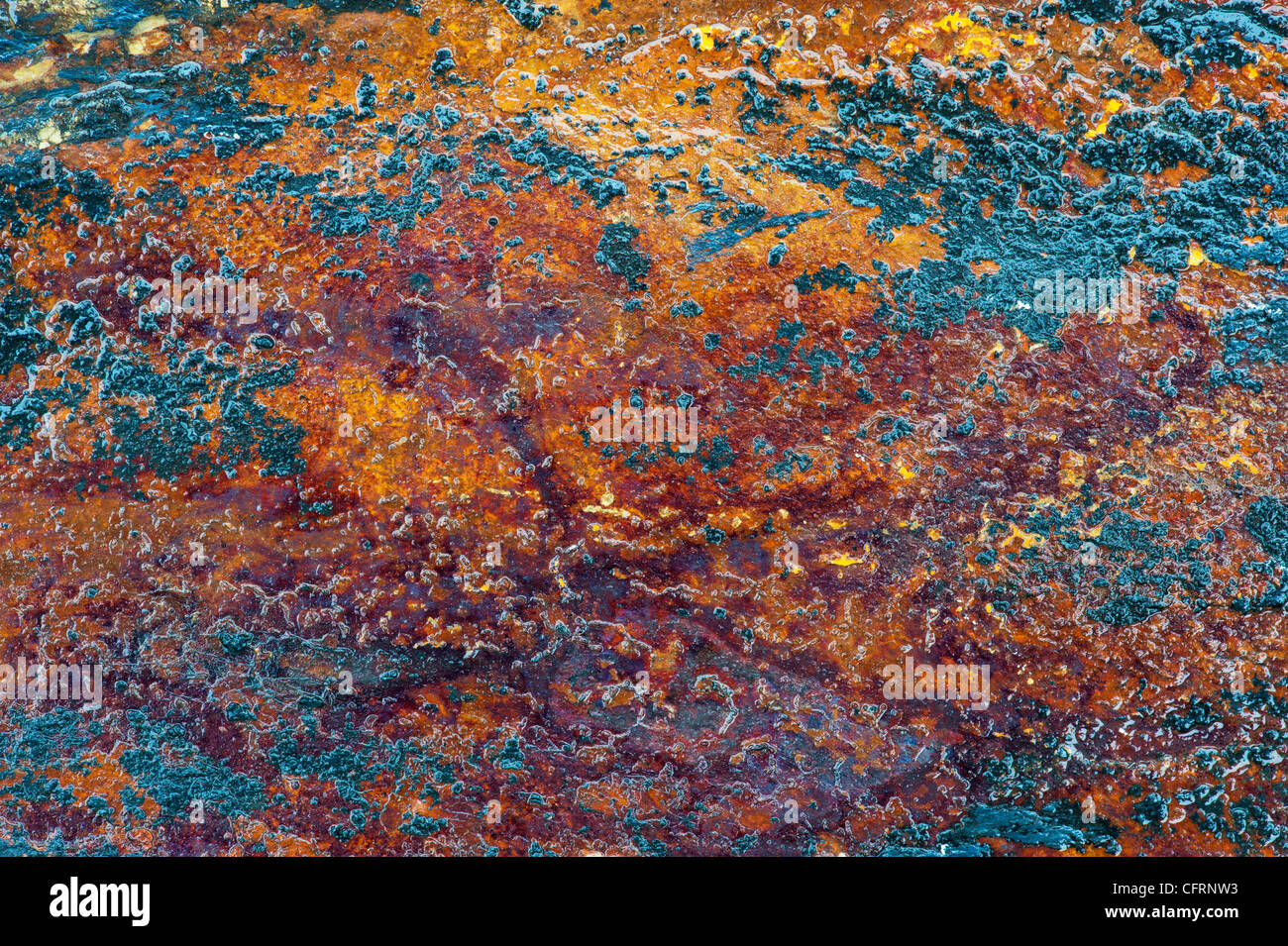 Wet oxidized coloured slate texture pattern - Stock Image