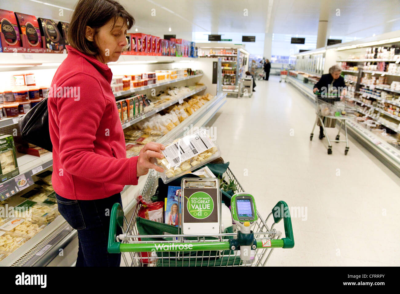 A woman shopping for food in Waitrose supermarket, UK - Stock Image
