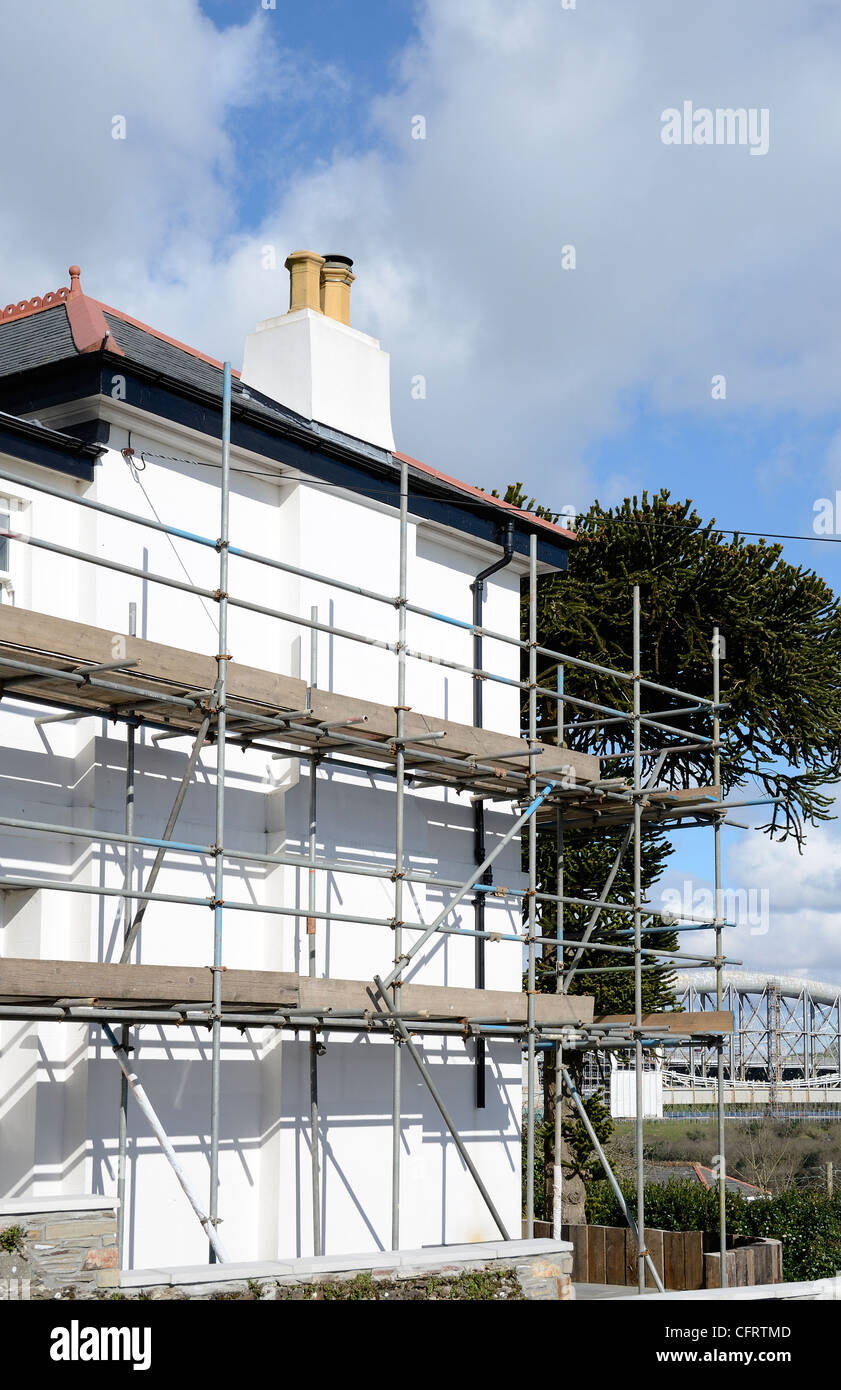 Scaffolding around a house undergoing some repairs - Stock Image