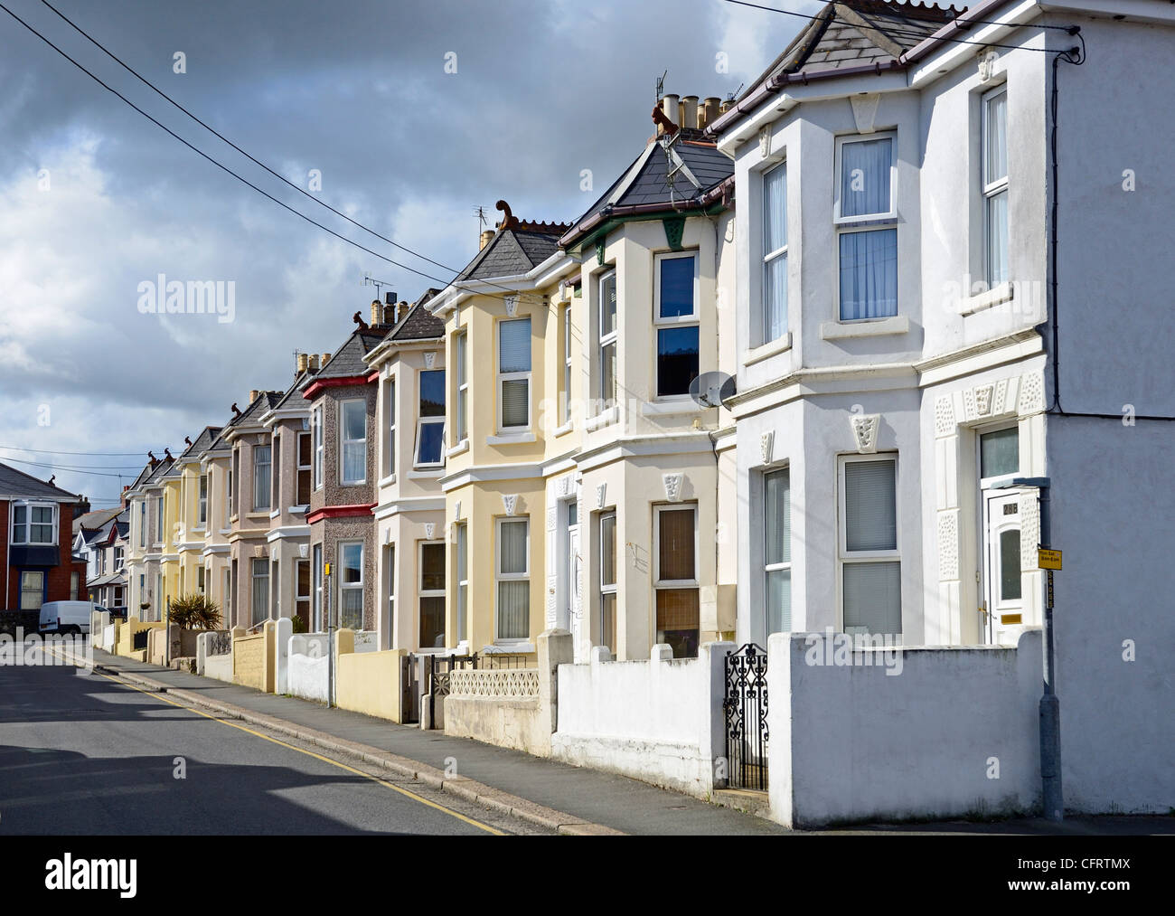 A street of terraced houses with bay windows, saltash, cornwall, uk - Stock Image