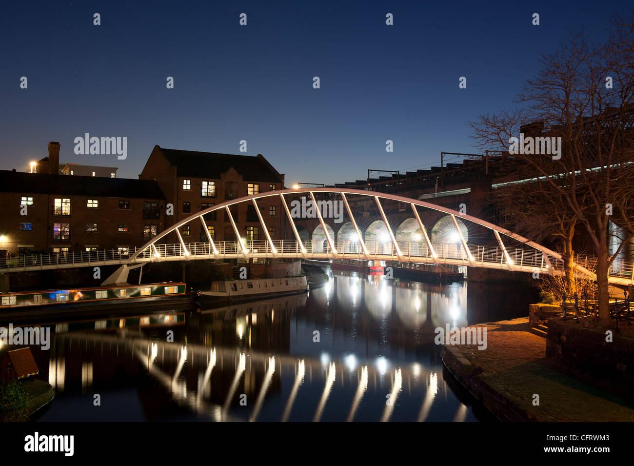A night shot of a canal basin Castlefield, Manchester. - Stock Image