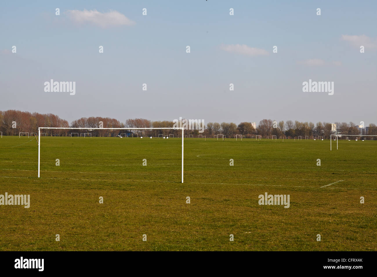 A large number of football pitches stand unused on a sunny day - Stock Image