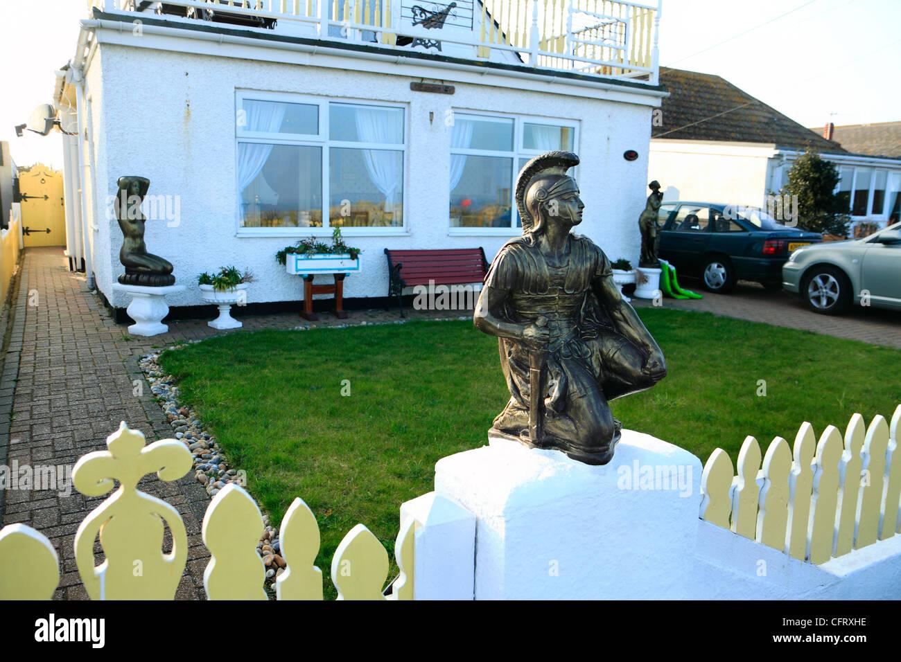 Ornamental Roman Centurion figure on gatepost of house, Greatstone, Kent - Stock Image