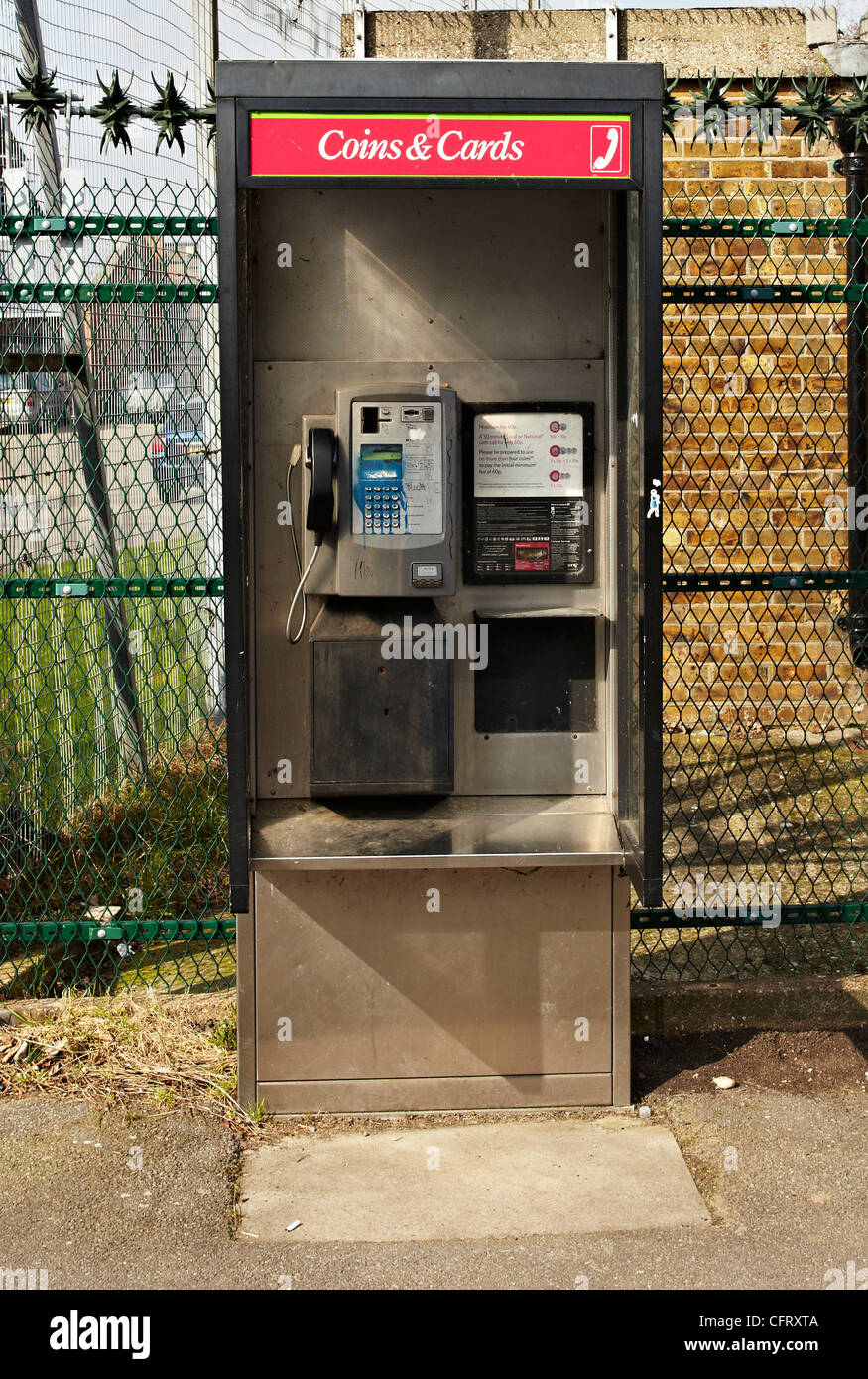 Open Style BT telephone box that takes coins and cards - Stock Image